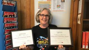 Ellen holding Bronze and Silver Star certificates.