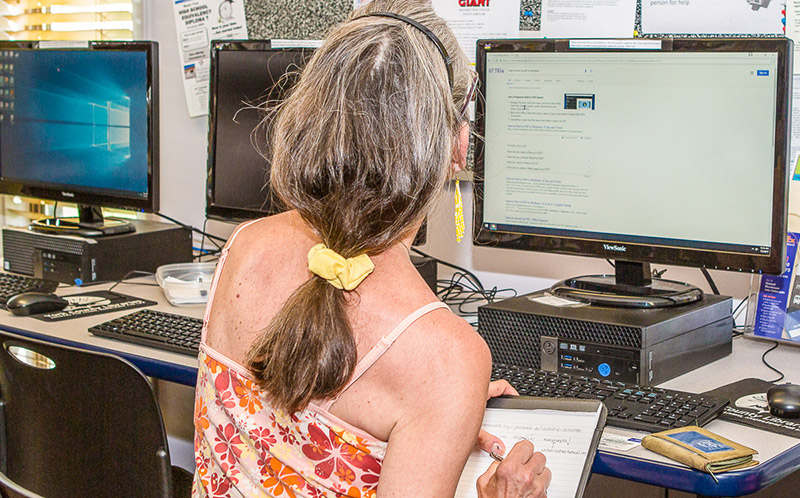 Woman Using Free Computers