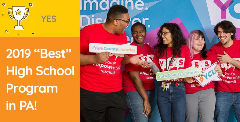 Teens celebrating Youth Empowerment Summit award