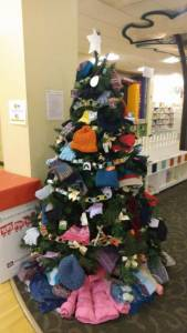 Photo of Warming Tree with gloves, hats, scarves, coats.